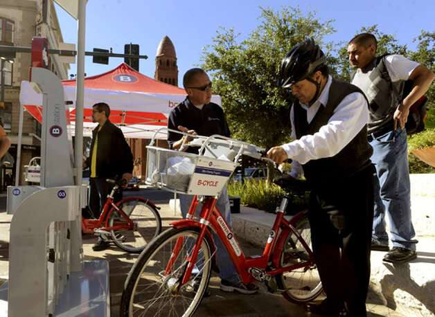 Len Trevino tries a bicycle during a demonstration of the San Antonio B-Cycle program, which will establish 14 kiosks in the central area of the city where bicycles can be rented and returned.