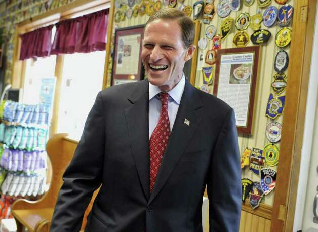 Democratic U.S. Senate candidate Richard Blumenthal laughs during a campaign stop at a diner in Enfield, Conn., on Friday, Oct. 29, 2010. Blumenthal faces Republican Linda McMahon in the Nov. 2 election. (AP Photo/Jessica Hill) Photo: Jessica Hill, AP / AP2010