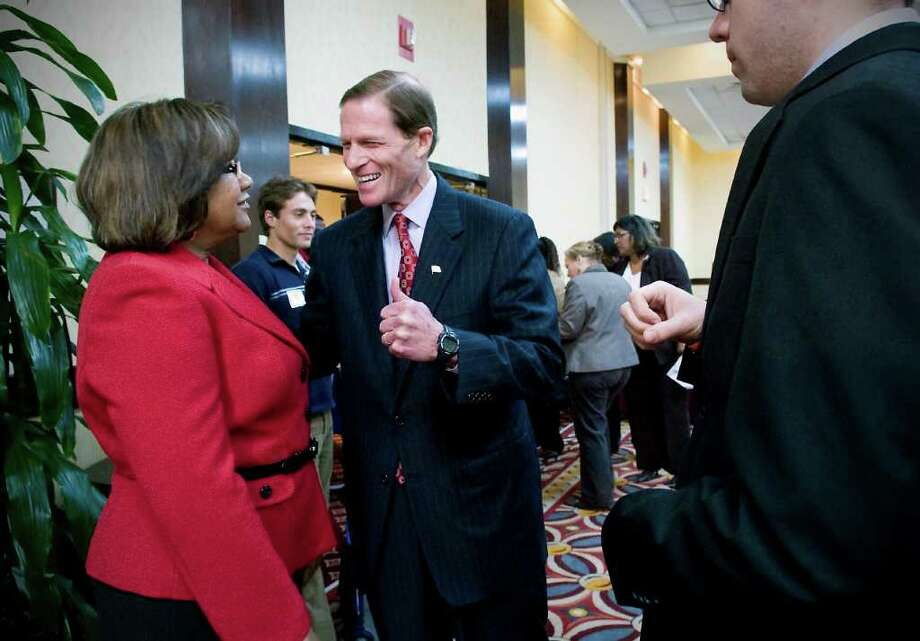 "Democratic Senate candidate Richard Blumenthal greets Brenda Milner during a ""Meet the Candidates"" luncheon at the Connecticut NAACP State Convention 2010 at the Holiday Inn Stamford in Stamford, Conn. on Saturday October 30, 2010. Photo: Kathleen O'Rourke / Stamford Advocate"