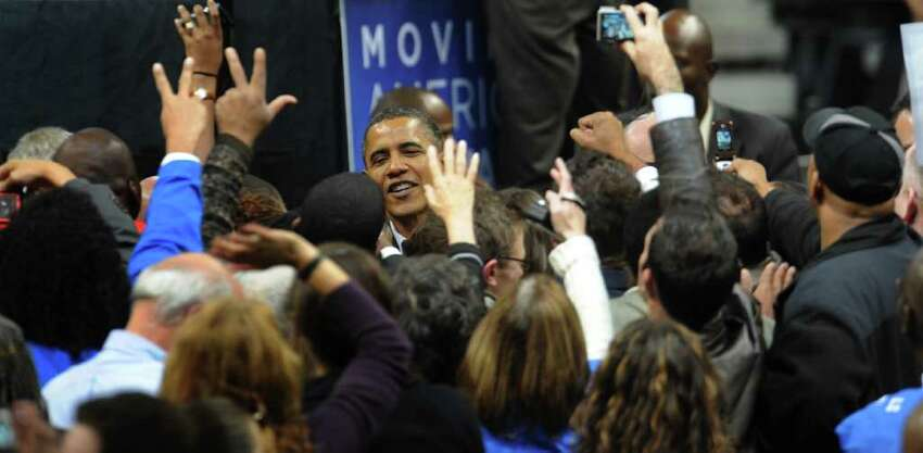 President Obama greets people in the crowd after speaking at the Arena at Harbor Yard in downtown Bridgeport, Conn. on Saturday October 30, 2010.