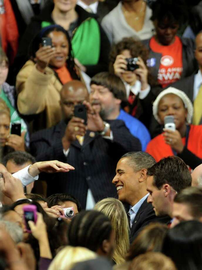 President Obama, at lower right, greets people in the crowd after speaking at the Arena at Harbor Yard in downtown Bridgeport, Conn. on Saturday October 30, 2010. Photo: Christian Abraham / Connecticut Post