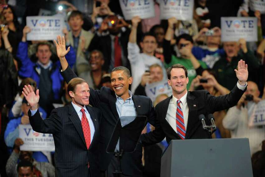 President Obama, center, stands with Connecticut Attorney General Richard Blumenthal, left, and US Representative Chris Himes, after Obama spoke at the Arena at Harbor Yard in downtown Bridgeport, Conn. on Saturday October 30, 2010.