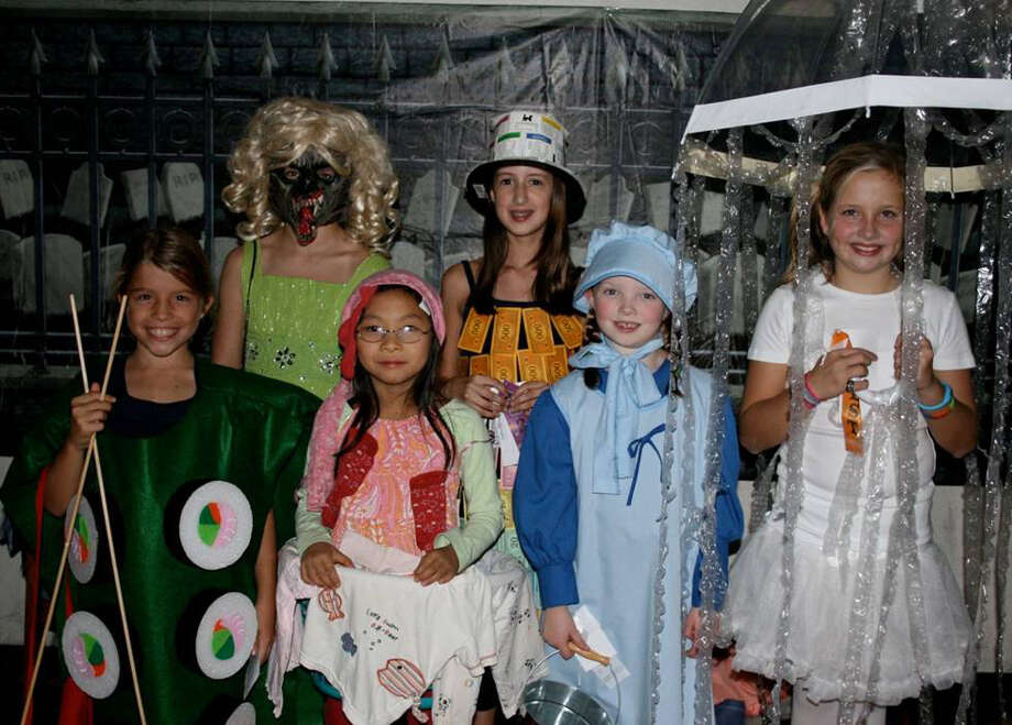 Nearly 350 Girl Scouts attended a Halloween dance last week at Town Hall. Six Scouts were honored for their  costumes. Front row, from left, Eloise LeClerc (Runner Up Funniest), Charlotte Juan (Winner Funniest), Olivia Golden (Winner Cutest) and Cate VanElslander (Winner Best). Back row from left, Fiona Taney (Winner Scariest) and Lucy Armstrong (Winner Original). Photo: Contributed Photo / Darien News