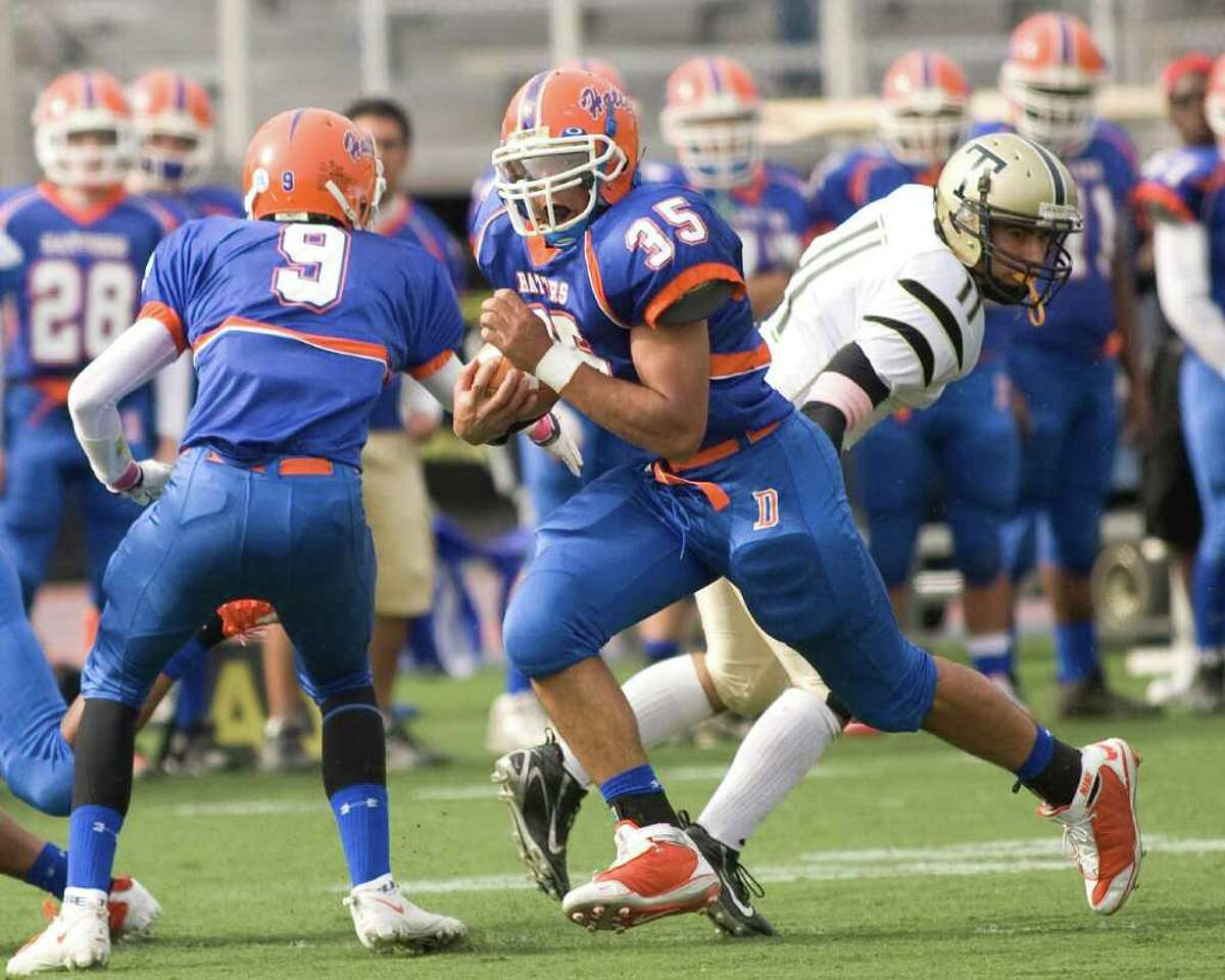 Danbury's Austin Calitro (35) gave the Hatters an early lead on this touchdown run against Trumbull Saturday, Oct. 31, 2010, at Danbury High School.