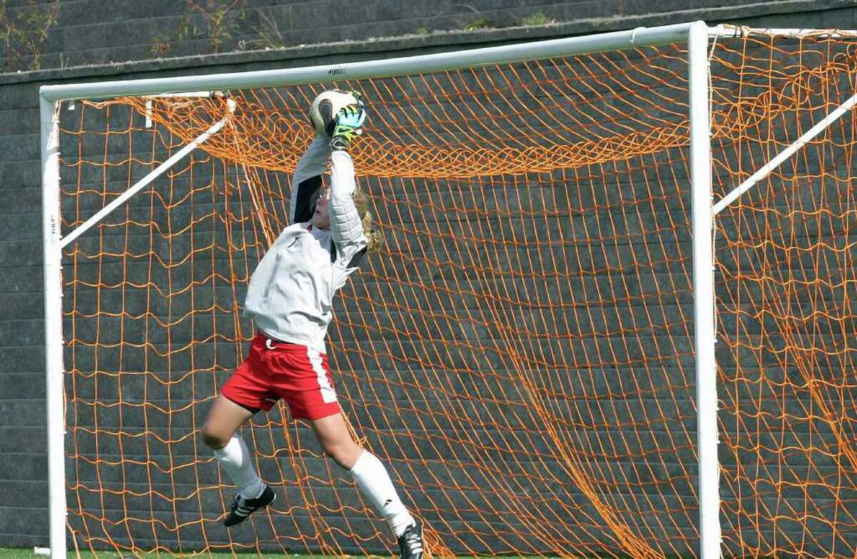 Greenwich High goalie Taylor Bucklin makes a save during the Cardinals' 2-0 win over Warde in the FCIAC quarterfinals on Saturday, Oct. 30, 2010.
