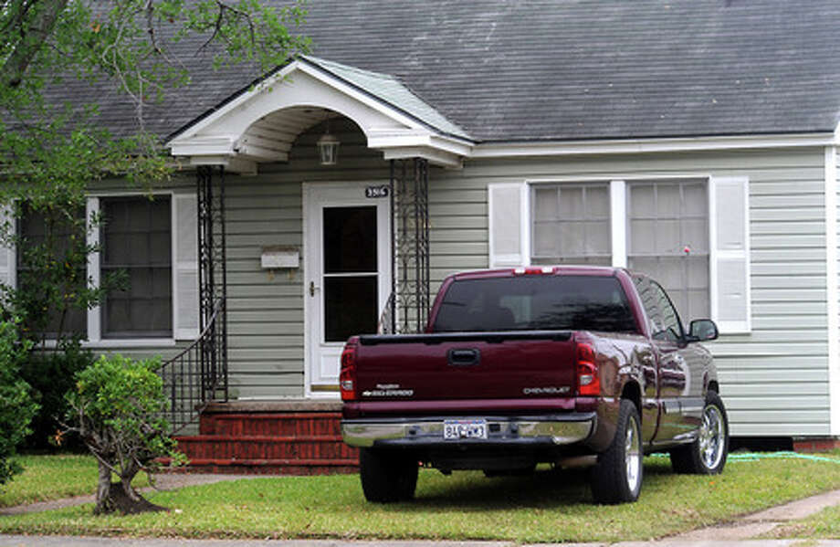 A vehicle sits in the yard at a home in Port Arthur, Thursday. Tammy McKinley, The Enterprise