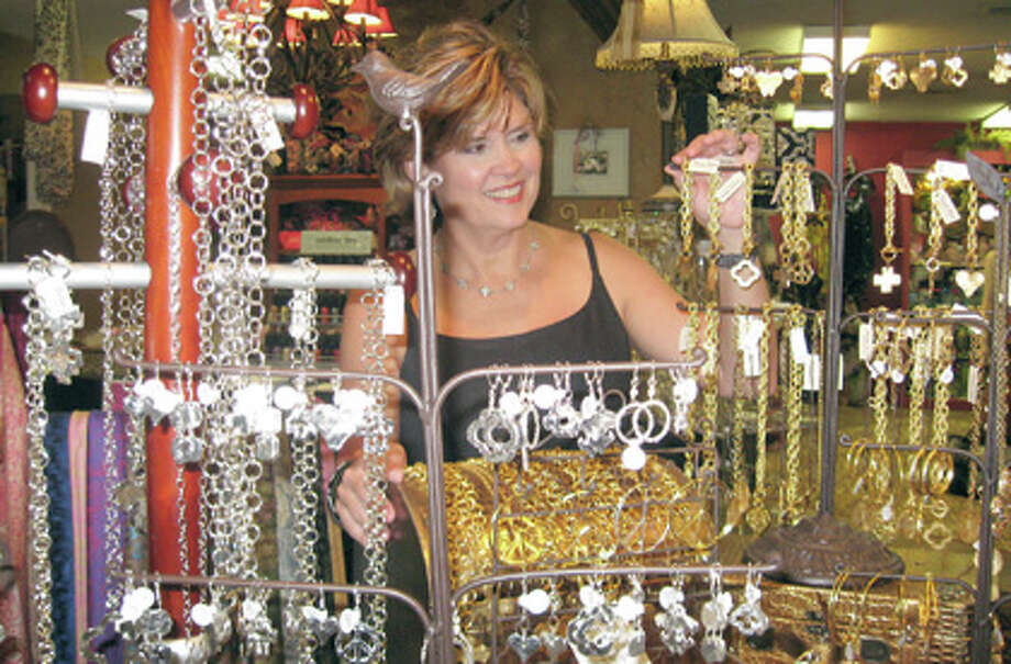 BBS Collection owner Pam Edwards shows off a jewelry display at the store. Edwards has owned the store for 14 years. Heather Nolan/The Enterprise