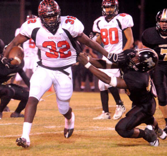 Kirbyville's Broderick Jackson shakes off Anahuac's Danario Williams at LC-M in Mauriceville.