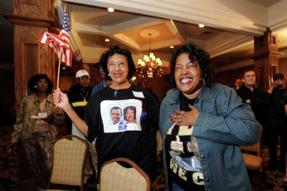 Bobbie Granger, left, and Bobbie Patterson, right, react to hearing that Barack Obama clenched enough electoral votes to be the  44th President of the United States during a night watch party for the Jefferson County Democratic Party at The Neches Room on Crockett Street. Tuesday, November 4, 2008. Valentino Mauricio/The Enterprise