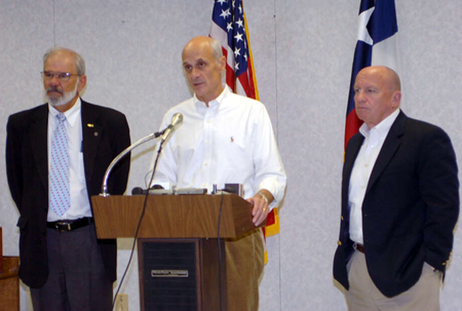 Homeland Security Secreatry Michael Chertoff, center, Orange County Judge Carl Thibodeaux, left, and Congressman Kevin Brady answered questions from the media after meeting with other local officials about the speed of FEMA aid to Hurricane Ike victims. Pete Churton/The Enterprise