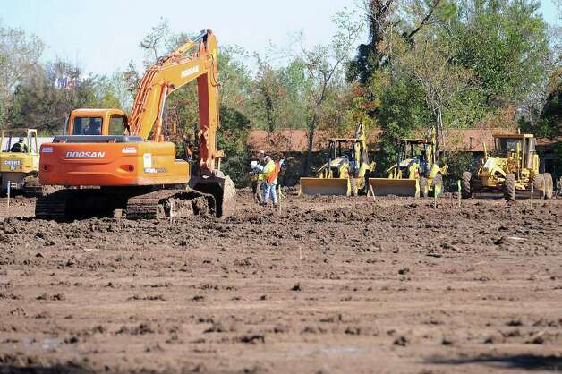Bulldozers level ground in Bridge City's Acadian subdivision making room for Texas' first FEMA trailer park. Several homeowners living in the subdivision said the value of their property will diminish. Tuesday, November 25, 2008. Guiseppe Barranco/The Enterprise