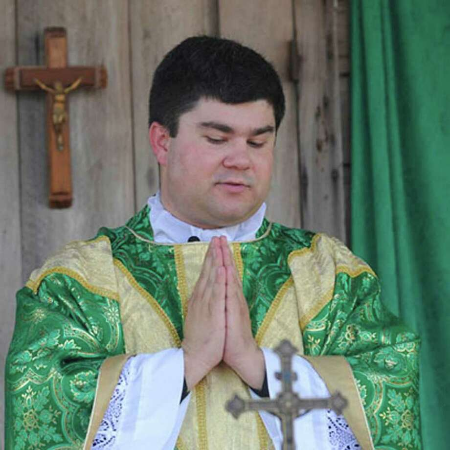 Father Joshua Guillory, of Ville Platte, LA, conducts the 19th Annual Acadien French Mass at La Maison Beausoleil Museum at Port Neches River Front Park on Sunday, October 12, 2008. Valentino Mauricio/The Enterprise