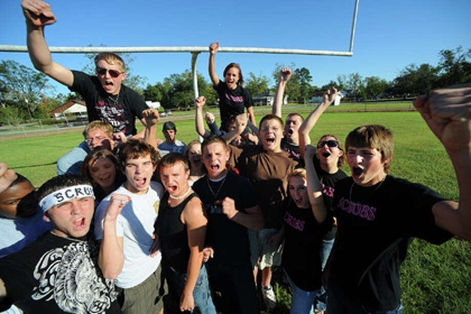 Several Silsbee students show school spirit on a football field in Tiger town on Wednesday. Five of the students are banned from attending the school's homecoming game for wearing paint during a recent football game. Guiseppe Barranco/The Enterprise