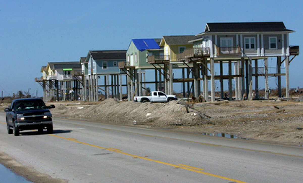 A row of homes, built by Crown Team Texas of Beaumont, are still standing in the town of Gilchrist after the passage of Hurricane Ike. The homes are located on Texas 87, on the bay side of the peninsula, heading towards the Bolivar ferry landing. Dave Ryan/The Enterprise