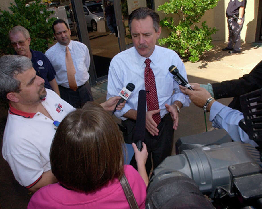 R. David Paulison, the Administrator of the Federal Emergency Management Agency, speaks to the Beaumont media before leaving in a van with other FEMA officials.  Dave Ryan/The Enterprise