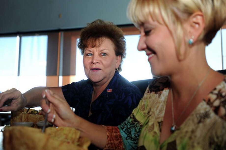Faye Woodsmall has lunch with her daughter, Cherry Woodsmall at the Monterey House in Beaumont, Friday. Tammy McKinley, The Enterprise