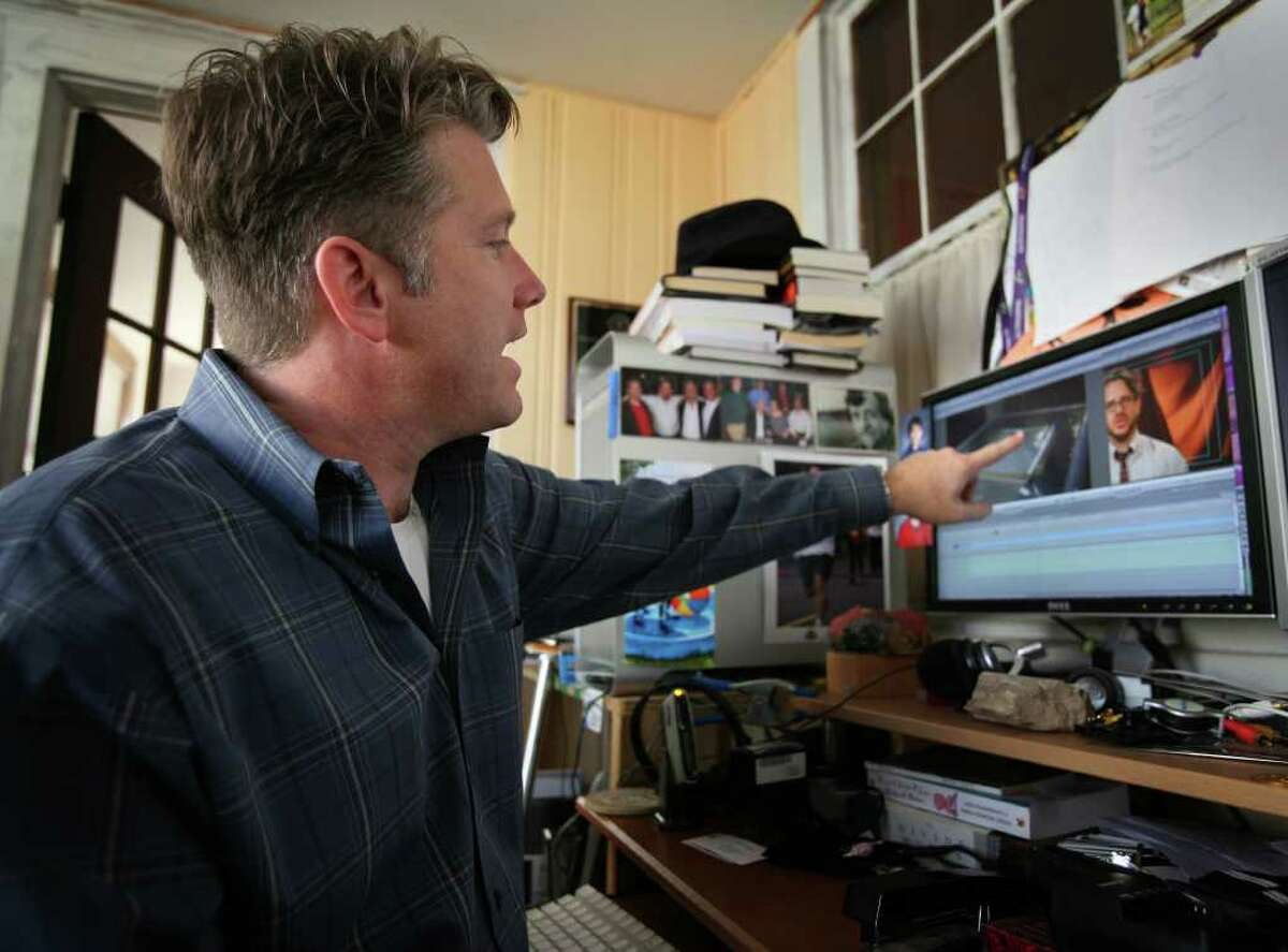J. Sibley Law edits videos for the Worldwide Web in his home office in Stratford.