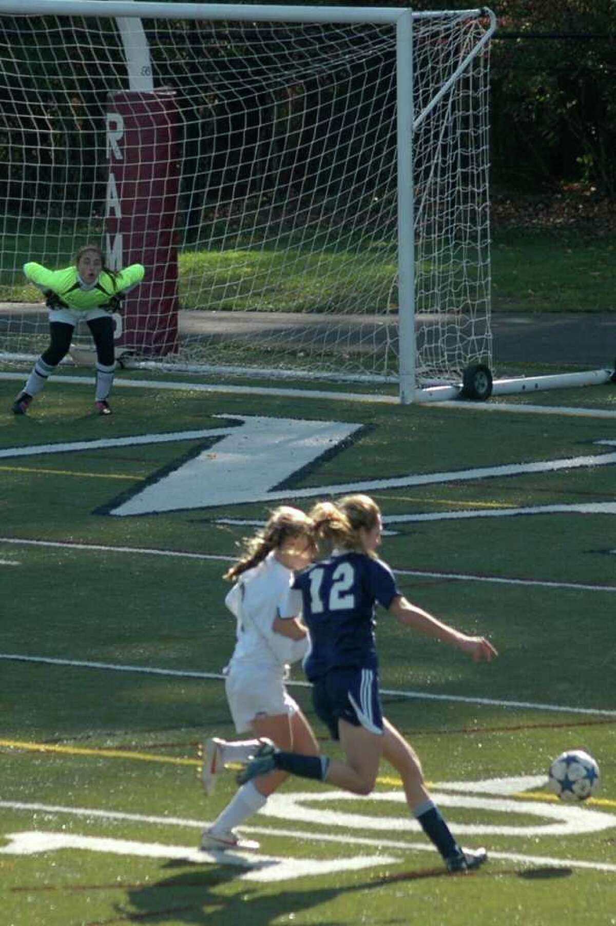 Staples senior tri-captain Jaclyn Katz eludes a New Canaan defender on Saturday in the FCIAC quarterfinals. Katz scored three goals in leading the sixth-seeded Lady Wreckers to a 4-1 victory.