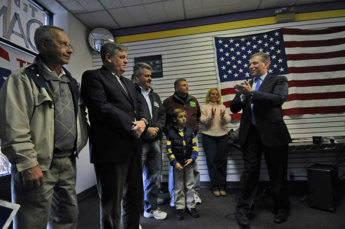 Harry Wilson, Republican candidate for the office of state comptroller, far right, speaks during a rally for Republican candidates at the headquarters of Ted Danz, far left, who is running for Congress against incumbent Democrat Paul Tonko, on Sunday October 31, 2010 in Colonie, NY. Assembly candidate Steve McLaughlin is third from left, and State Senate candidate Bob Domenici is fourth from left. ( Philip Kamrass / Times Union )