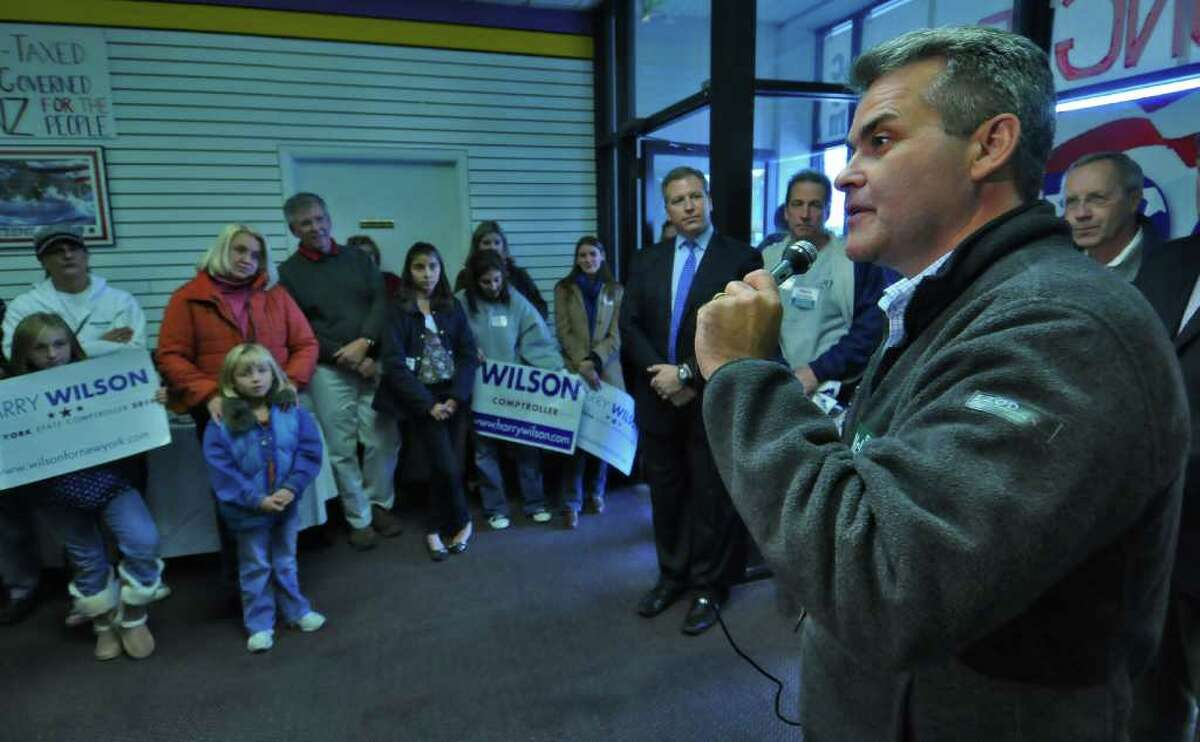 Republican Assembly candidate Steve McLaughlin, right, speaks while Harry Wilson, Republican candidate for the office of state comptroller, standing just to the left of McLaughlin's left hand, listens during a rally for Republican candidates at the headquarters of Ted Danz, just visible far right, who is running for Congress against incumbent Democrat Paul Tonko, on Sunday October 31, 2010 in Colonie, NY. ( Philip Kamrass / Times Union )