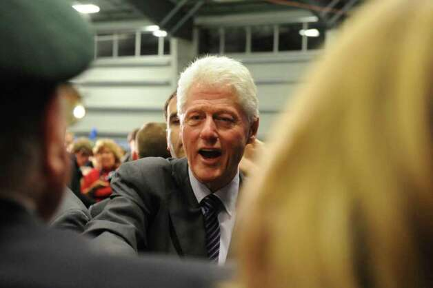 2010: Former President Bill Clinton chats with supporters at a rally for Congressman Jim Himes at SoNo Field House in Norwalk. Clinton was a featured speaker during the rally where Democratic candidates Dan Malloy and Richard Blumenthal also were on hand. Photo: Keelin Daly / Stamford Advocate