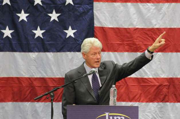 2010: Former President Bill Clinton joins Democratic Congressman Jim Himes in a rally for  at SoNo Field House in Norwalk. Clinton was a featured speaker during the rally where Democratic candidates Dan Malloy and Richard Blumenthal also were on hand. Photo: Keelin Daly / Stamford Advocate