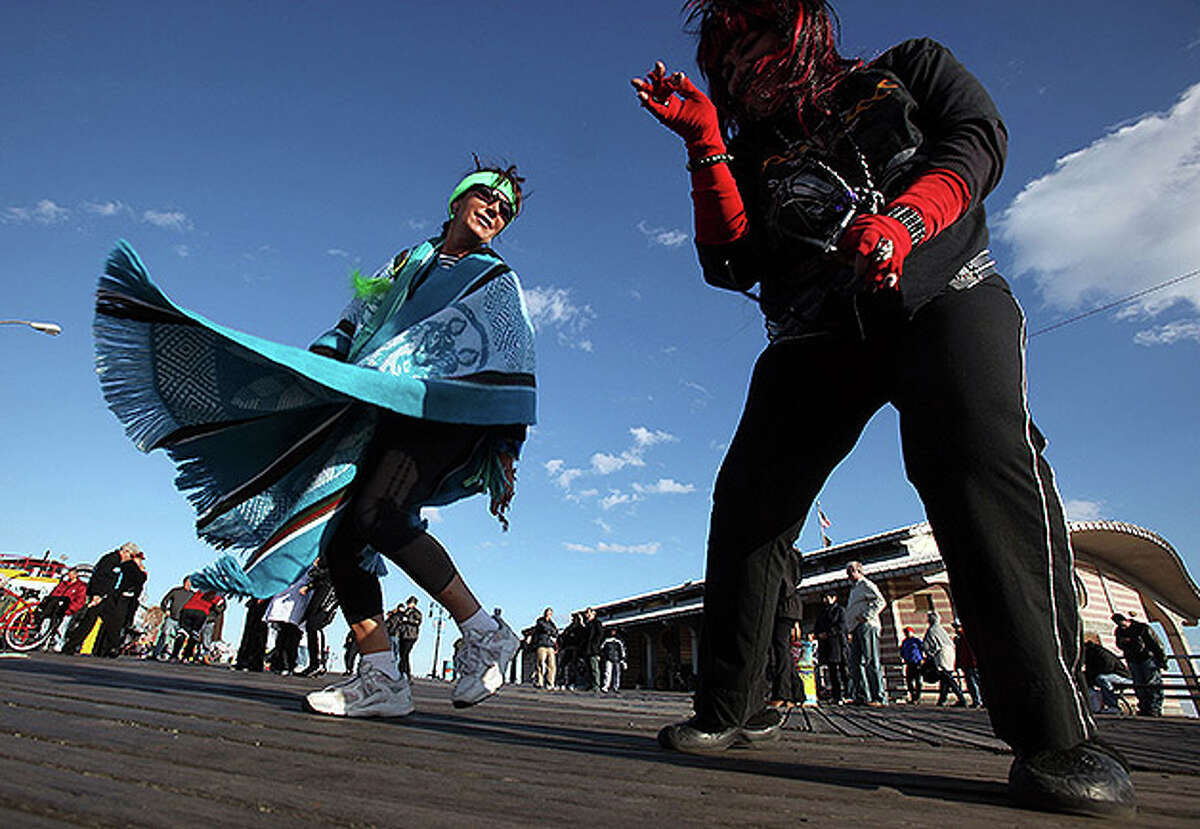 NEW YORK - OCTOBER 31: Costumed revelers dance on the boardwalk at historic Coney Island on Halloween October 31, 2010 in the Brooklyn borough of New York City. Revelers across the country are celebrating Halloween the day before the Christian tradition of All Saints' Day which honors the dead. (Photo by Mario Tama/Getty Images)