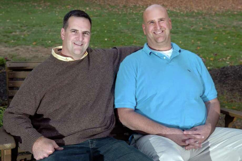 Richard Paul (left), of Trumbull, and his brother Brian, of Staten Island, have lived with Marfan syndrom their whole lives. The brothers are trying to raise awareness about Marfan after loosing both their father and two uncles to the genetic disorder. Photo: Ned Gerard / Connecticut Post