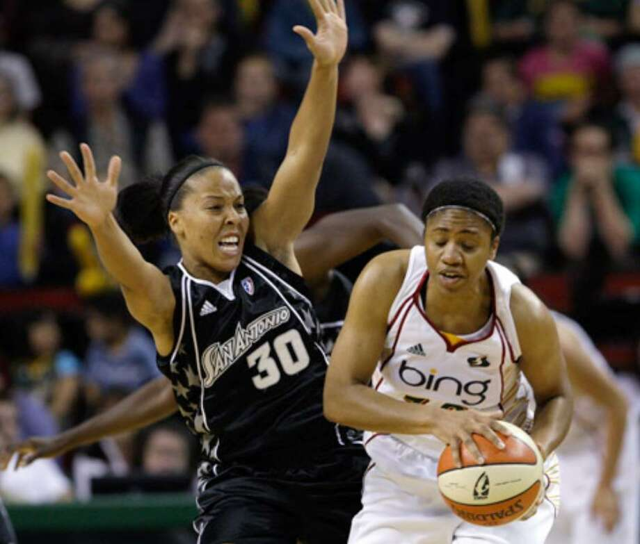 The Silver Stars' Helen Darling (left) defends the Storm's Tanisha Wright in the first quarter Tuesday, June 29, 2010, in Seattle.