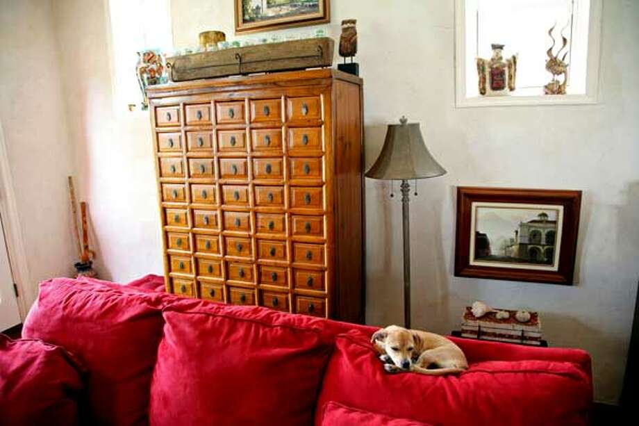 An 18th century Chinese apothecary chest in the living room of Brian and Nancy Cobb was bought in San Antonio.