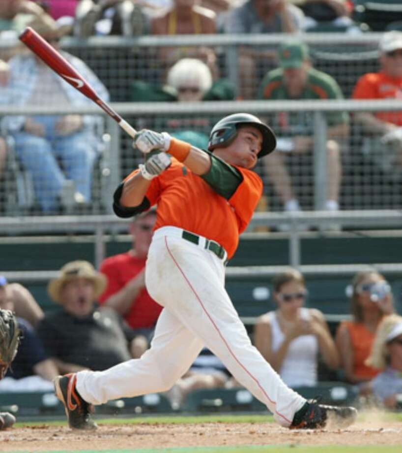 Miami's Scott Lawson connects on a home run against Texas A&M in the third inning of their game at the Coral Gables regional. The Aggies will face Dartmouth at 11 a.m. today in an elimination game.
