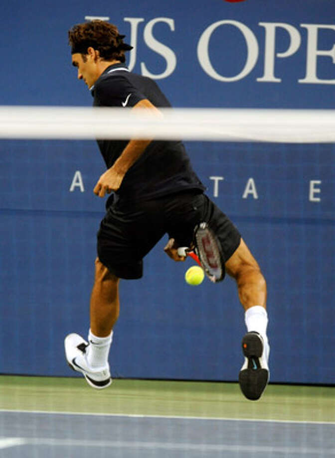 Swiss star Roger Federer hits a winner between his legs during his win over Argentina's Brian Dabul on Monday.