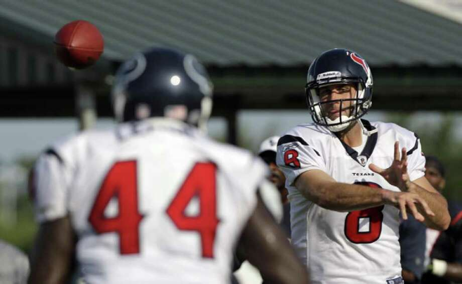 Texans quarterback Matt Schaub (8) throws a pass to fullback Vonta Leach during training camp Thursday in Houston. Schaub led the NFL in passing yards in 2009.