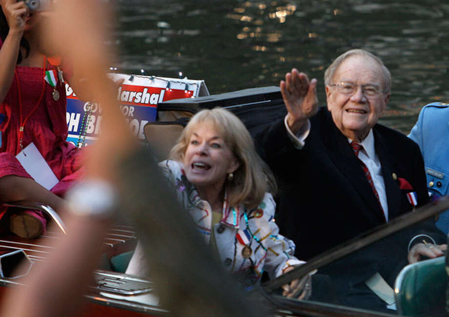 Former Gov. Dolph Briscoe rides a boat during the 2009 Texas Cavaliers River Parade on Monday, April 20, 2009.
