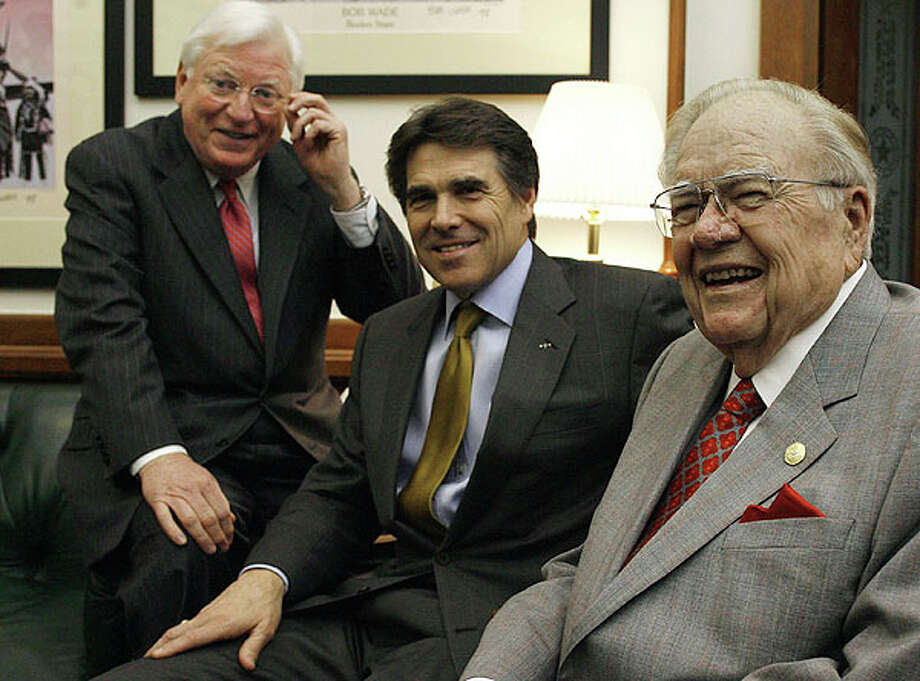 Former Texas governors Mark White (left) and Dolph Briscoe (right) pose with Gov. Rick Perry in his office April 4, 2007, in Austin. The two made the visit to endorse Perry's cure for cancer initiatives.