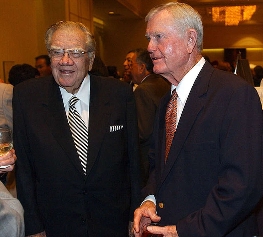 Former Gov. Dolph Briscoe (left) and former University of Texas football coach Darrell K. Royal talk Oct. 1, 2003 at the Father Flannigan Girls and Boys Town Spirit of Youth Gala held at the Marriott Rivercenter. / SAN ANTONIO EXPRESS-NEWS