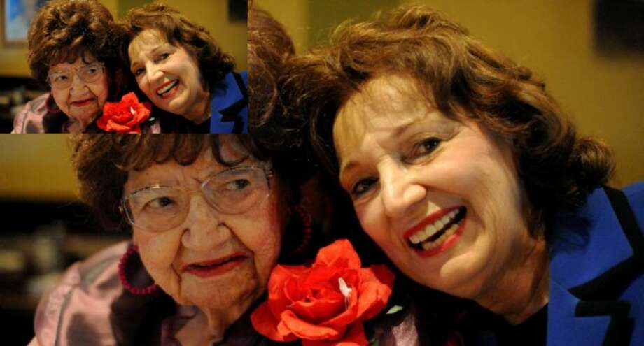Maria Cantu Garza (left), who was Queen of Fiestas Patrias in 1927, sits with her daughter, Maria Cimodocia Garza, during a celebration in honor of her 100th birthday at Los Cucos restaurant on Saturday.
