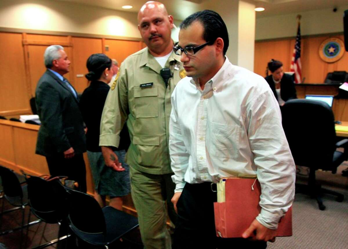 John Allen Rubio is led out of court in Edinburg, July 26, 2010, after he was found guilty of capitol murder of the three children of his common-law wife Angela Camacho in 2003. A jury is now considering Rubio's punishment.