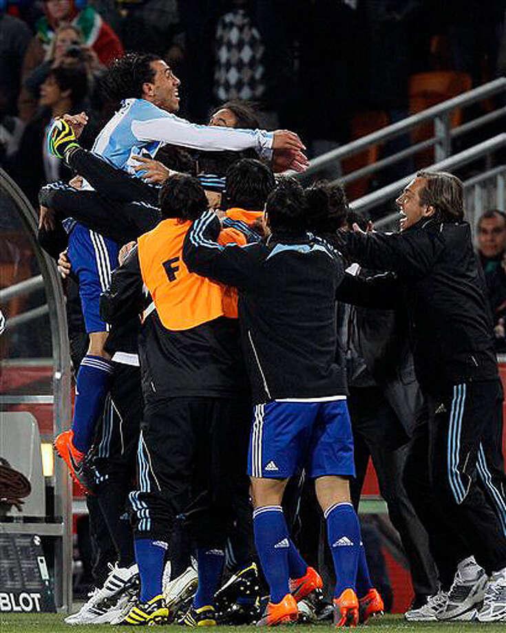 Carlos Tevez (top left) celebrates after scoring Argentina's third goal against Mexico.