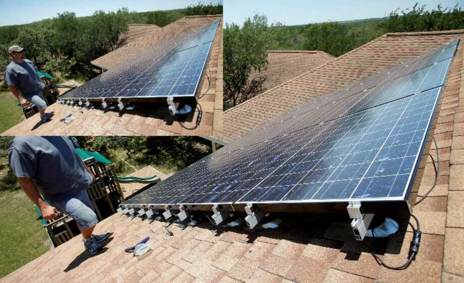 San Antonio officials are trying to figure out how to use part of the city's Retrofit Ramp-Up Award to help homeowners afford the big upfront costs of installing solar panels like these on a home in Bexar County.