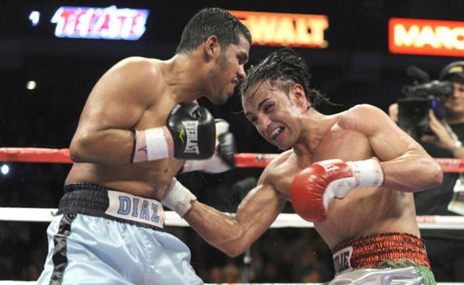 Juan Diaz (left) fights Paulie Malignaggi last December.