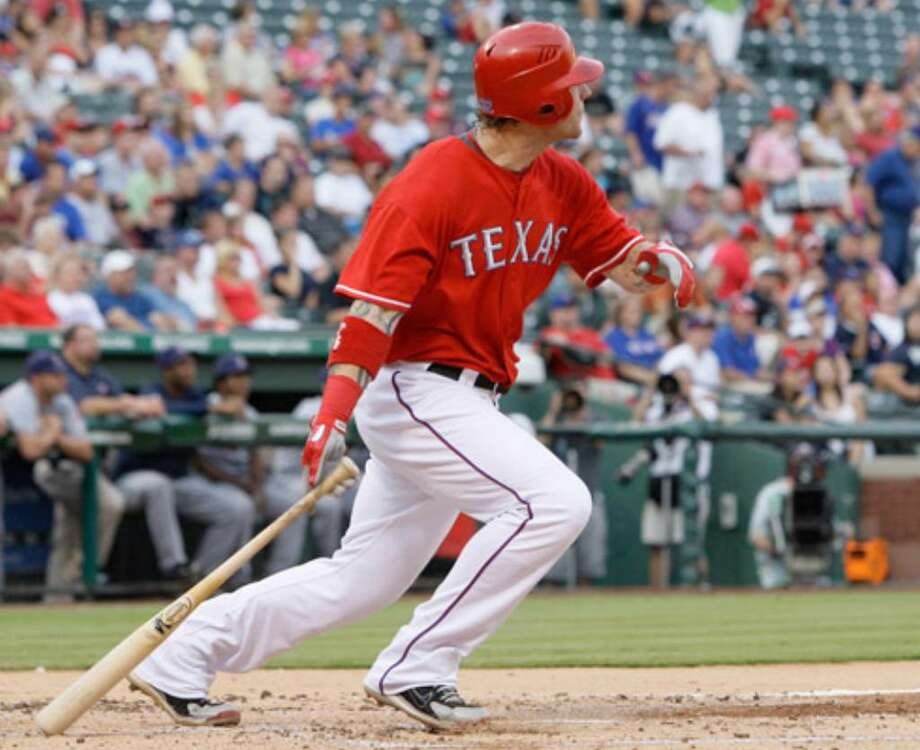 Texas Rangers' Josh Hamilton watches his solo home run off of Cleveland Indians starting pitcher Justin Masterson in the second inning.