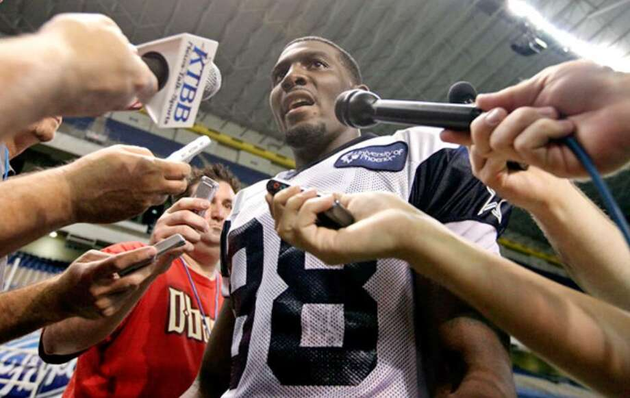 Wide receiver Dez Bryant, selected in the first round in April, answers questions from the media after the morning practice session Sunday.