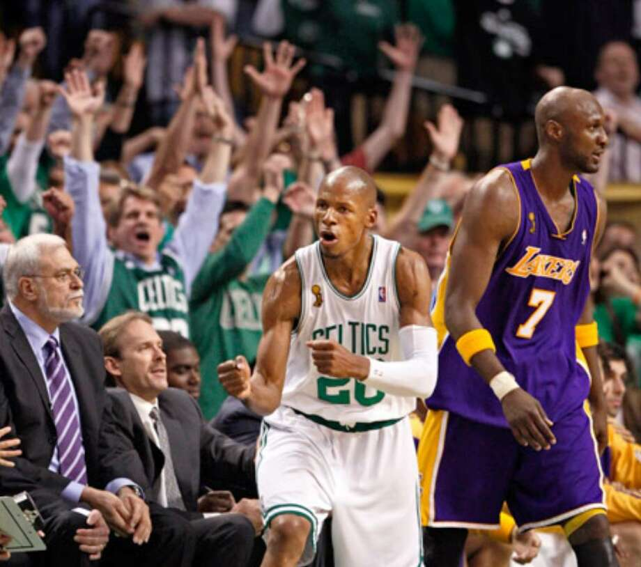 Boston's Ray Allen celebrates in front of Los Angeles' Lamar Odom and Lakers coach Phil Jackson as Boston won Game 6 to take the 2008 Finals.