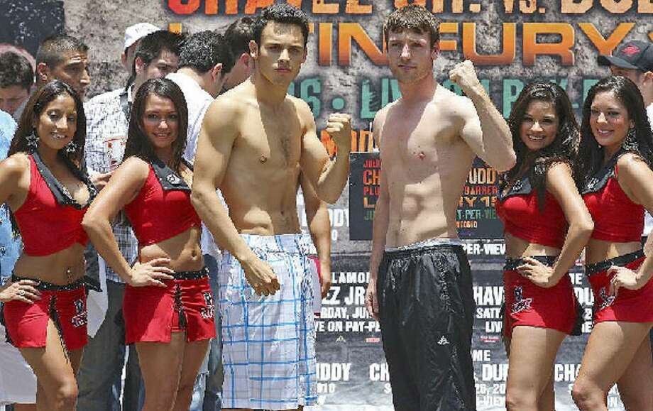 Julio Cesar Chavez Jr. (left), who is 40-0-1, and John Duddy (29-1) pose for photos during their weigh-in Friday at the Arneson River Theater.