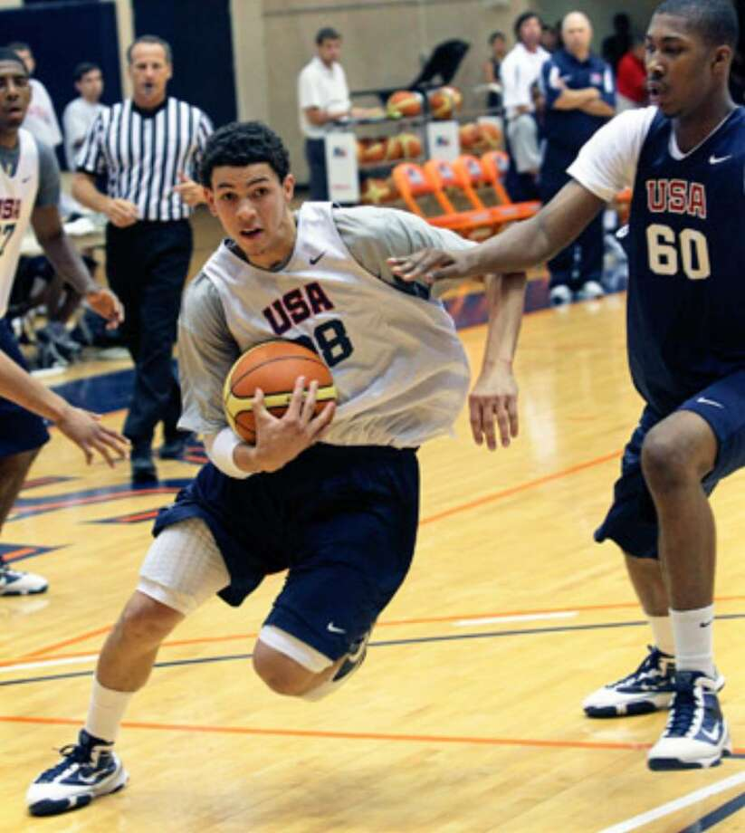 Austin Rivers, driving to the basket during tryouts Tuesday at the UTSA Convocation Center, was one of 12 players selected for the U.S. under-18 national team.