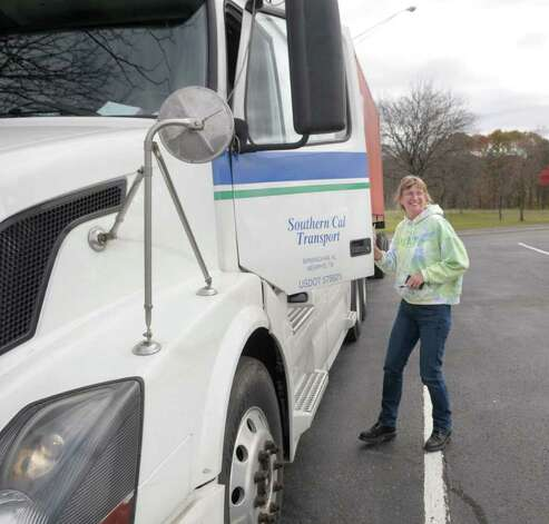 Penny Batchelor from Glenmore, Pa., who has been a trucker for 22 years, gets back into her truck after as she made a pit stop  at the Schodack Interstate 90 rest stop in Schodack, NY on Monday, Nov. 1, 2010.  (Paul Buckowski / Times Union) Photo: Paul Buckowski / 00010889A