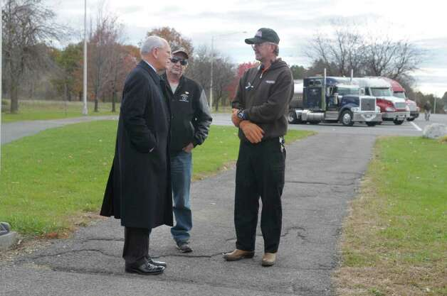 U.S. Rep. Paul Tonko, left, talks with truckers, Dale Bradley, center, from Canada, and Thomas Haggard, from Irving, Texas,   at the Schodack Interstate 90 rest stop  on Monday, Nov. 1, 2010.  (Paul Buckowski / Times Union) Photo: Paul Buckowski / 00010889A