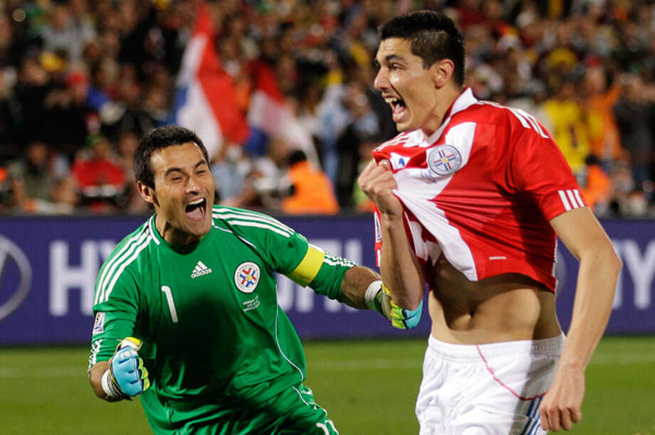 Paraguay?s Oscar Cardozo (right) celebrates with his goalkeeper, Justo Villar. Cardozo?s penalty kick put Paraguay in the quarterfinals after a 5-3 shootout victory over Japan.