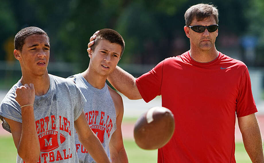 Danny Kloza (right), shown here at a recent spring practice session with quarterbacks Marcus Tiller (left) and Josh Sotelo, is Lee High School's new head coach and athletic coordinator. Kloza, a 1982 Lee graduate and former quarterback, also served as assistant coach at Lee for six years and spent the past six seasons as an assistant coach at MacArthur / Prime Time Newspapers 2010
